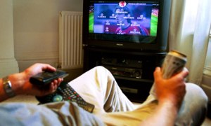 A man watching football on television