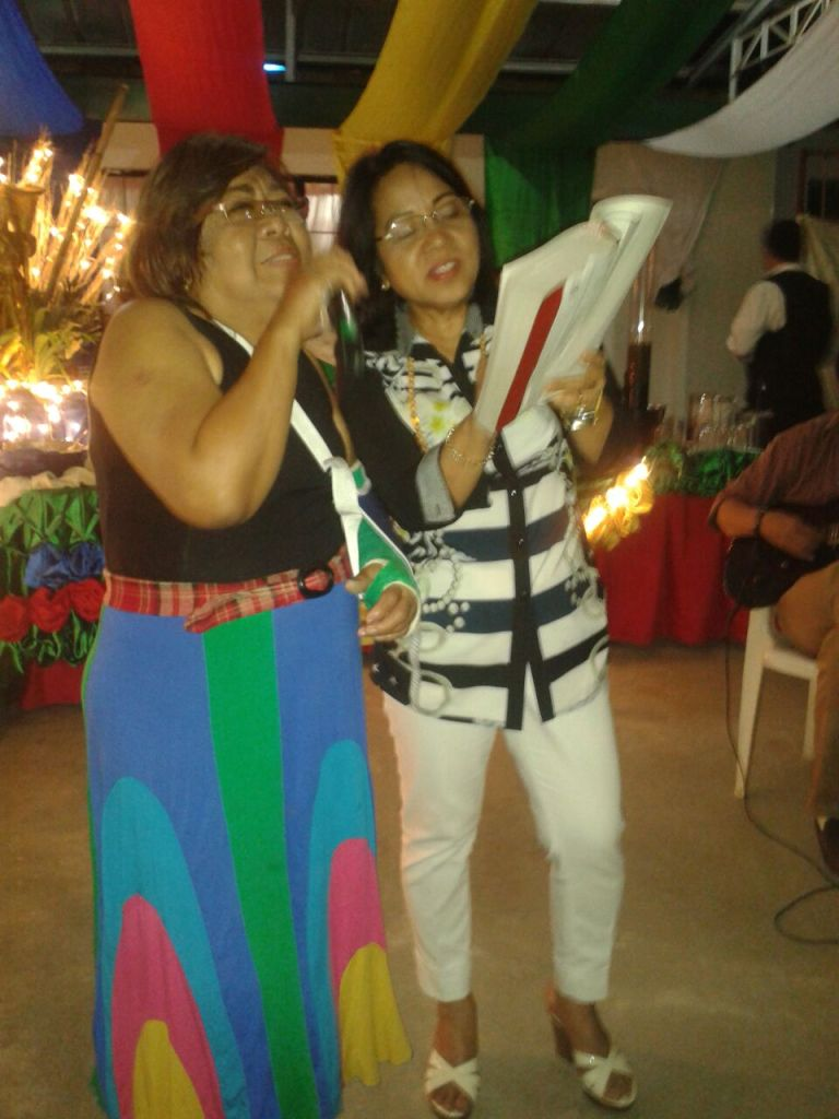 My Mom with her best friend Milette singing together at our party.