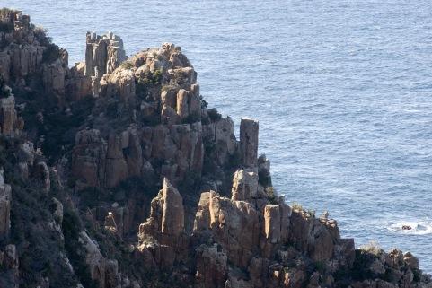 a jagged dolerite rock cliff on the tasman peninsula