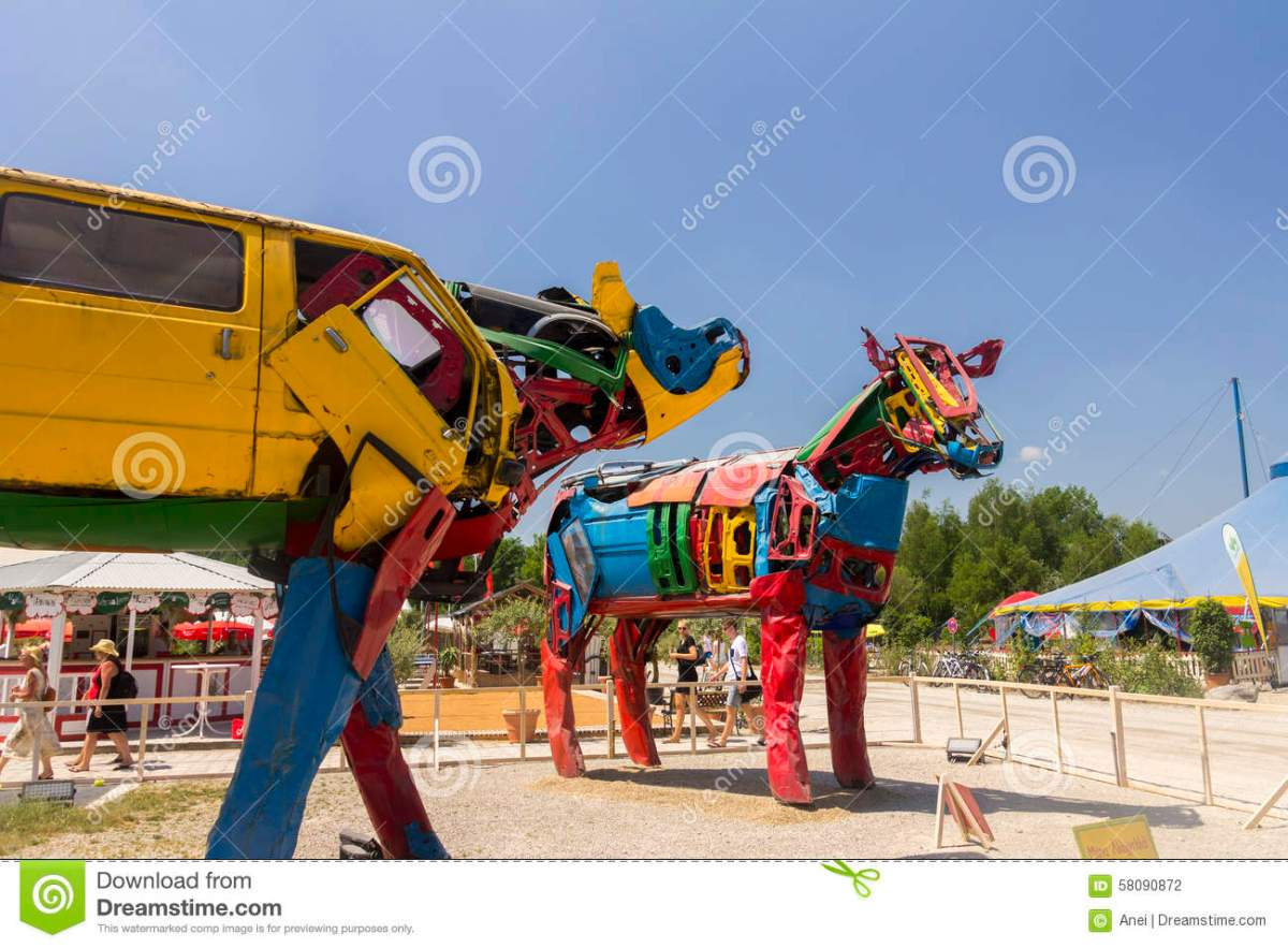 photo-two-cow-sculptures-old-car-parts-famous-alternative-summer-tollwood-festival-olympiapark-munich-58090872