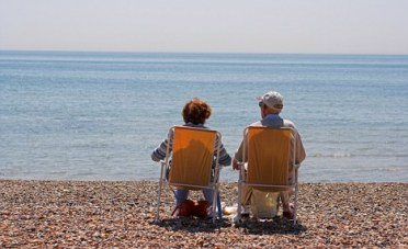 Watching time go by on the beach at Goring bt Sea. Image shot 2006. Exact date unknown.